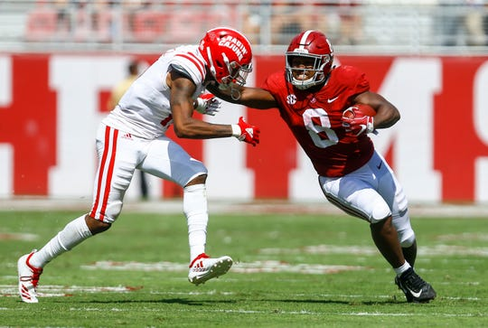 Alabama running back Josh Jacobs (8) stiff arms Louisiana-Lafayette defensive back Michael Jacquet III (11) as he carries the ball during the first half of an NCAA college football game, Saturday, Sept. 29, 2018, in Tuscaloosa, Ala. (AP Photo/Butch Dill)