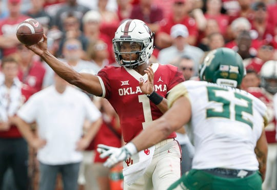 FILE - In this Saturday, Sept. 29, 2018, file photo, Oklahoma quarterback Kyler Murray (1) passes against Baylor in the first half of an NCAA college football game in Norman, Okla.  Murray threw for a career-high 432 yards with six TDs and also ran for a score when the three-time defending Big 12 champion Sooners beat Baylor last weekend. (AP Photo/Alonzo Adams, File)