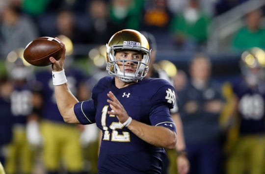 Notre Dame quarterback Ian Book throws during the second half of an NCAA college football game, Saturday, Sept. 29, 2018, in South Bend, Ind. (AP Photo/Carlos Osorio)