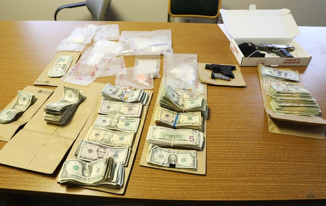 Drugs, cash and fire arms from a drug raid on Norwood Boulevard in Zanesville on display before a press conference by Muskingum County Sheriff Matt Lutz and Zanesville Police Department Chief Tony Coury on Thursday.