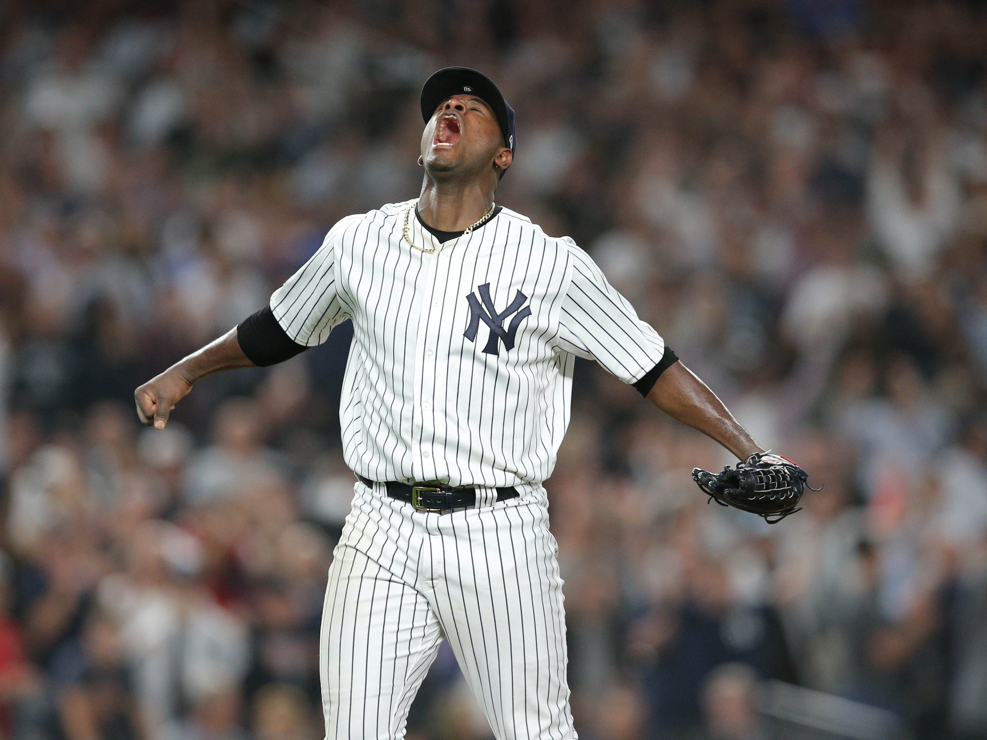 AL wild card: Yankees starting pitcher Luis Severino is pumped after striking out the Marcus Semien for the final out in the fourth inning with bases loaded.