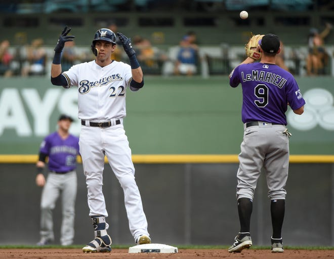 Christian Yelich reacts next to Rockies second baseman DJ LeMahieu during an August game at Miller Park.