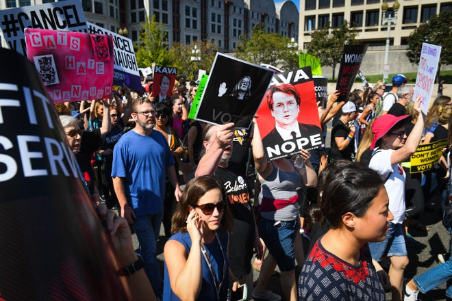 Hundreds of protesters march to the Supreme Court steps in a rally against Brett Kavanaugh in Washington, D.C., on Oct. 4, 2018.