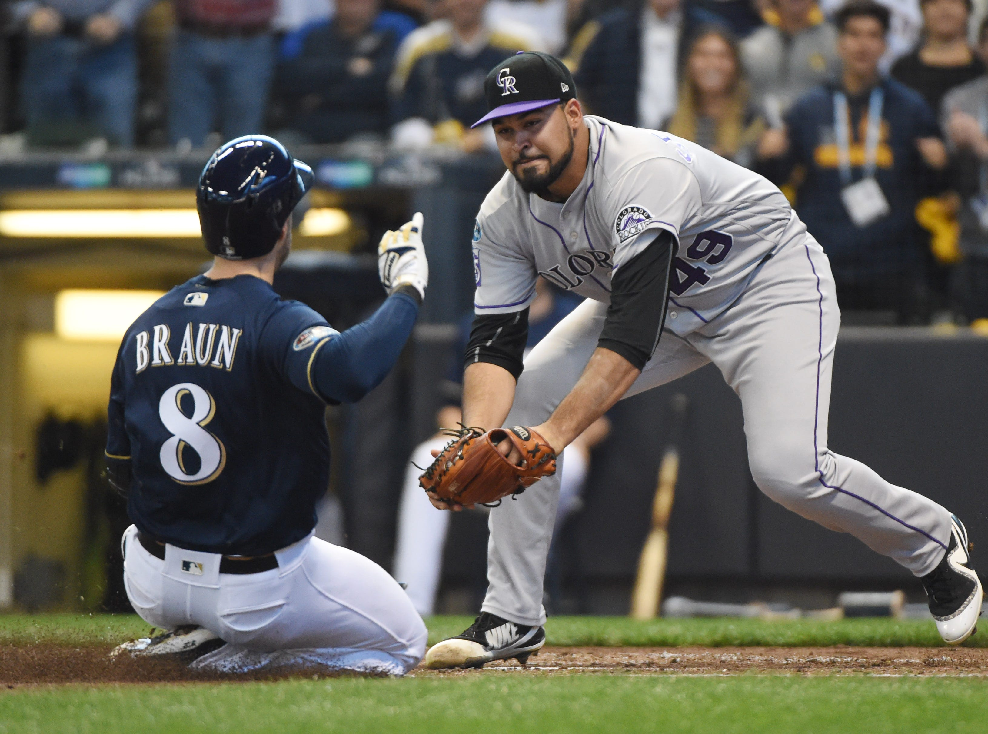 NLDS Game 1: Milwaukee's Ryan Braun is tagged out by Rockies pitcher Antonio Senzatela trying to score from second base on a wild pitch in the first inning.