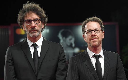 """Sibling filmmaking duo Ethan, right, and Joel Coen at the Venice premiere of """"The Ballad of Buster Scruggs"""" in August."""