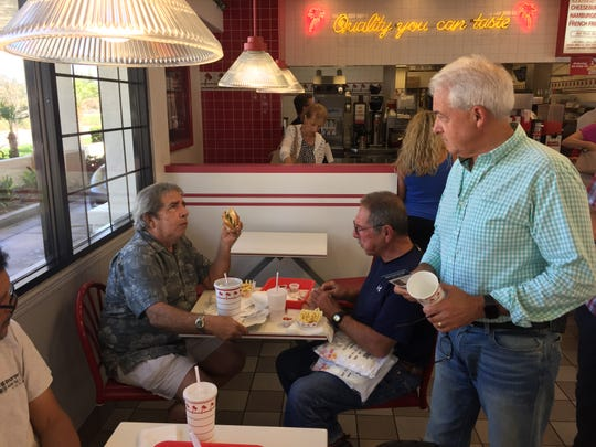 Republican gubernatorial hopeful John Cox talks to a diner at an In-N-Out burger stand north of Los Angeles.