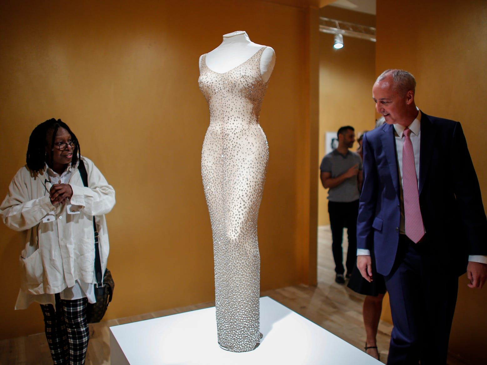 Whoopi Goldberg and Martin Nolan, Executive Director of Julien's Auctions speak next to the Marilyn Monroe iconic 'Happy Birthday Mr. President' dress during a press preview at MANA Contemporary Museum in Jersey City, N.J.