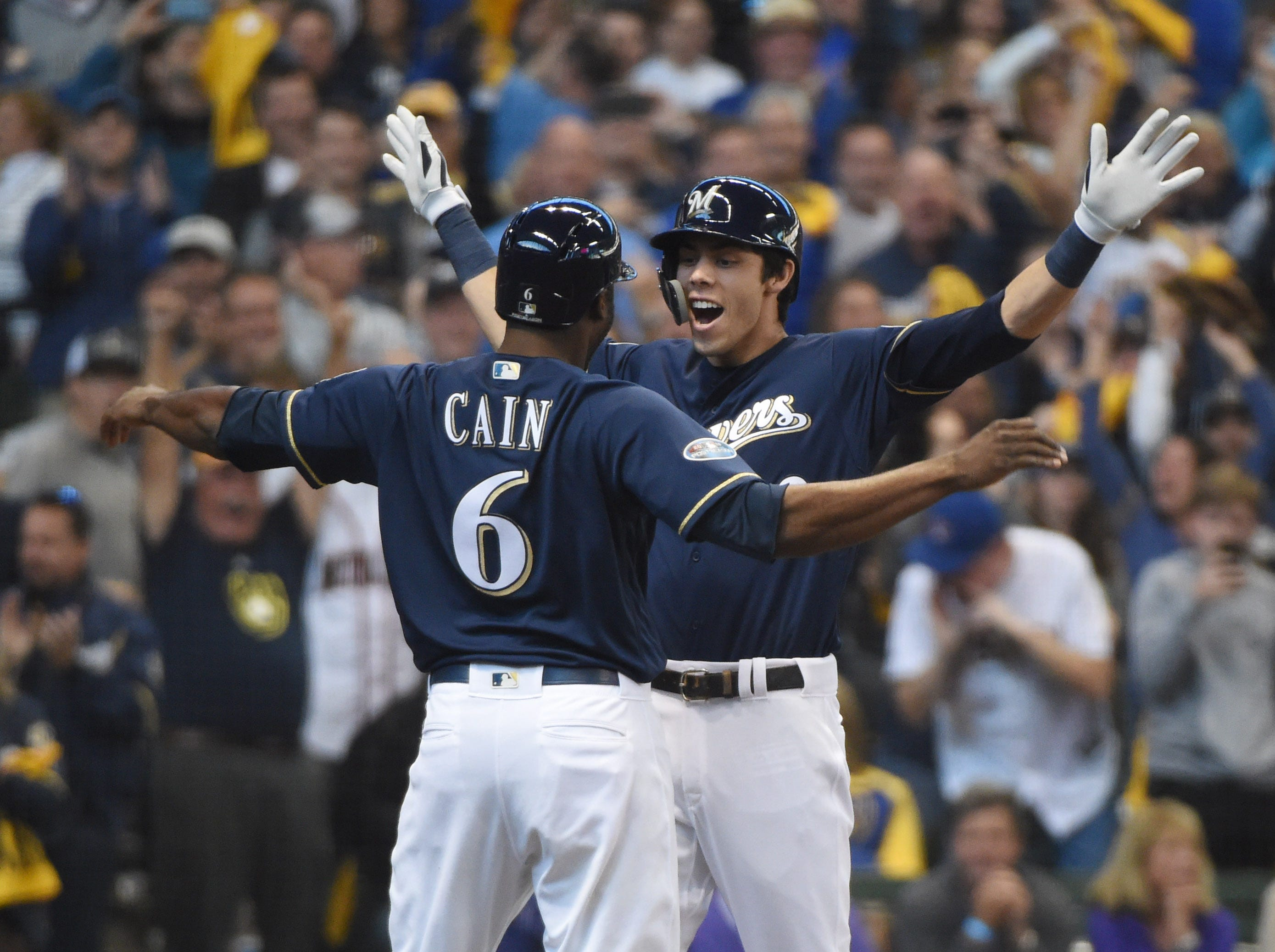 NLDS Game 1: Brewers outfielder Christian Yelich celebrates his home run with teammate Lorenzo Cain in the third inning.