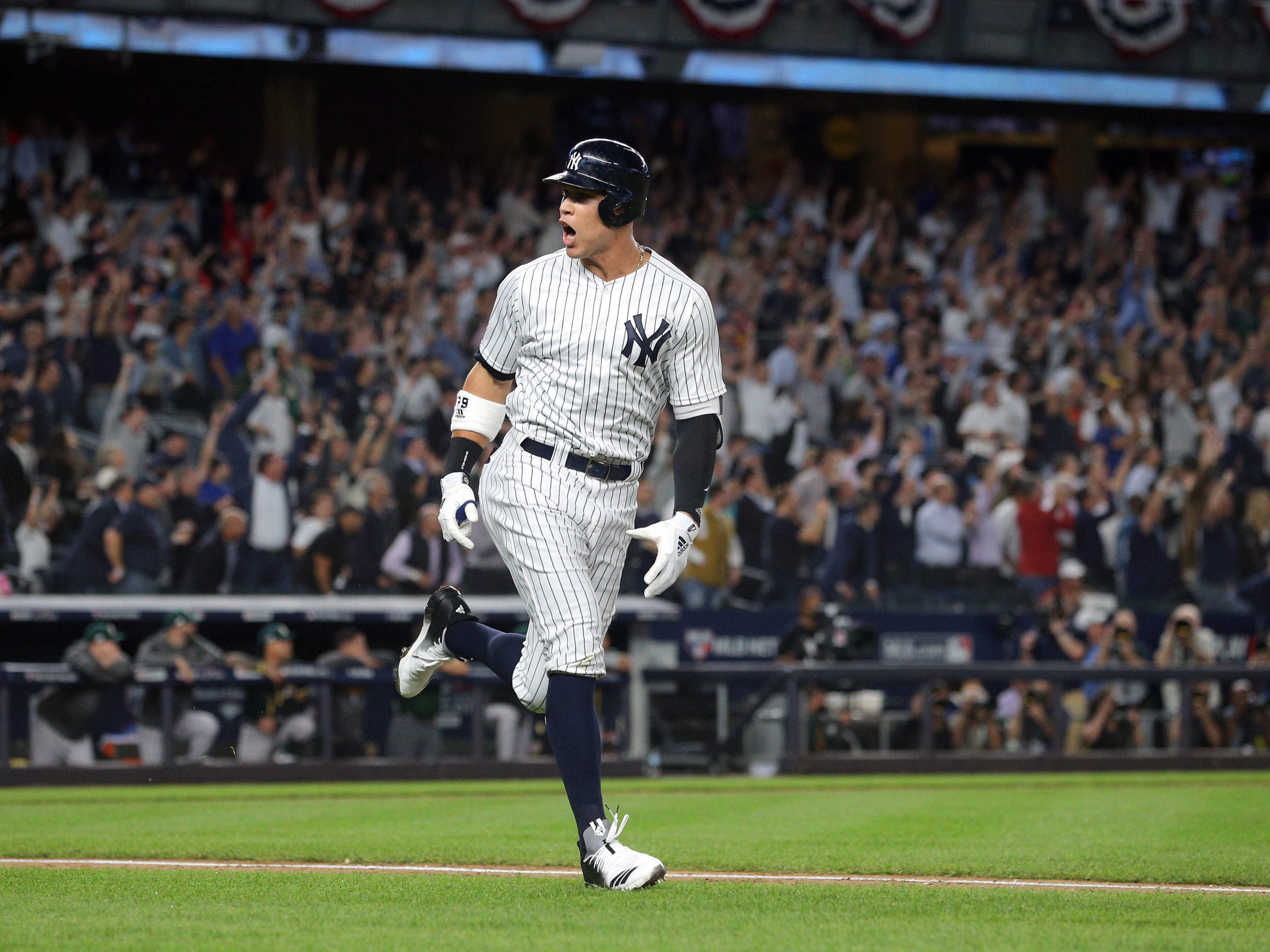 AL wild card: Yankees' Aaron Judge looks toward the dugout after crushing a two-run home run.