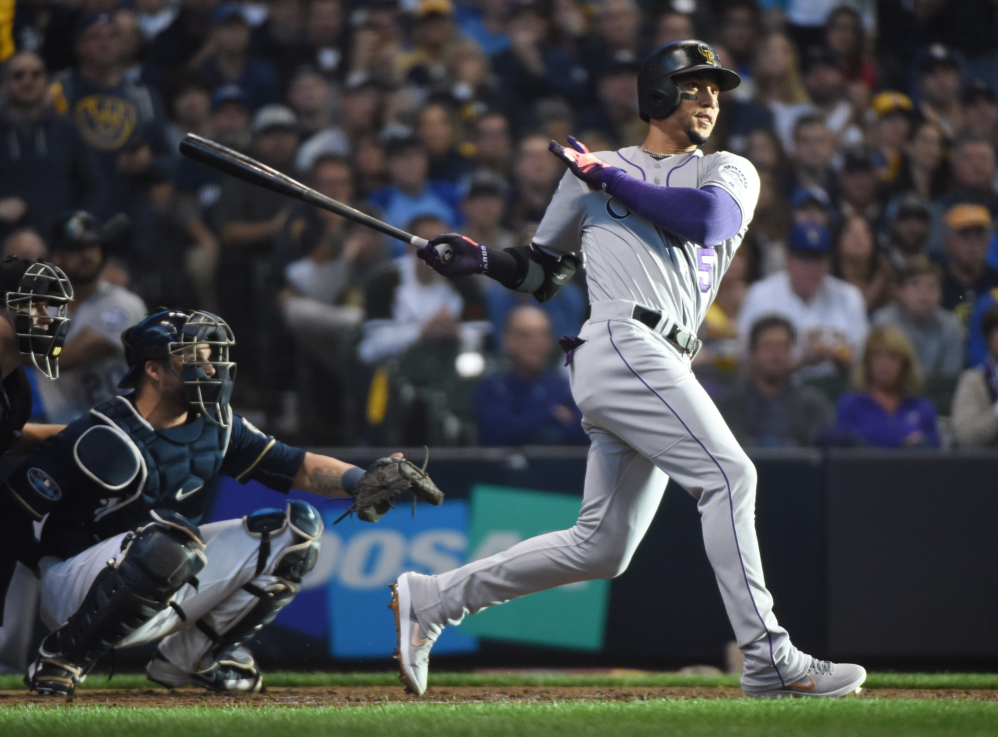 NLDS Game 1: Rockies outfielder Carlos Gonzalez triples in the fifth inning.