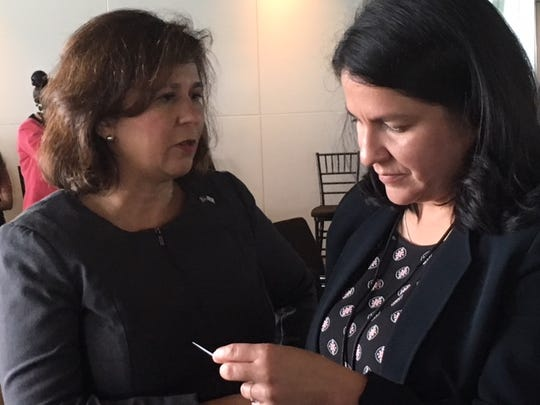 Rhode Island Secretary of State Nellie Gorbea, left, and Kira Romero-Craft, associate counsel for LatinoJustice PRLDEF, right, confer after speaking July 24 , 2018, at the Election Assistance Commission summit on language assistance in Washington, D.C.