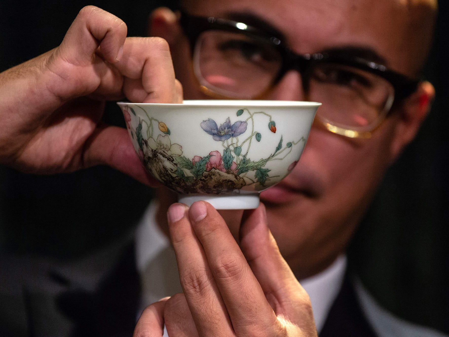 A Falangcai Poppy Bowl is displayed during a media preview for the Sotheby's Chinese Works of Art Autumn Sales in Hong Kong on Aug. 30, 2018. - The bowl sold for $2,1621,622.13 USD.