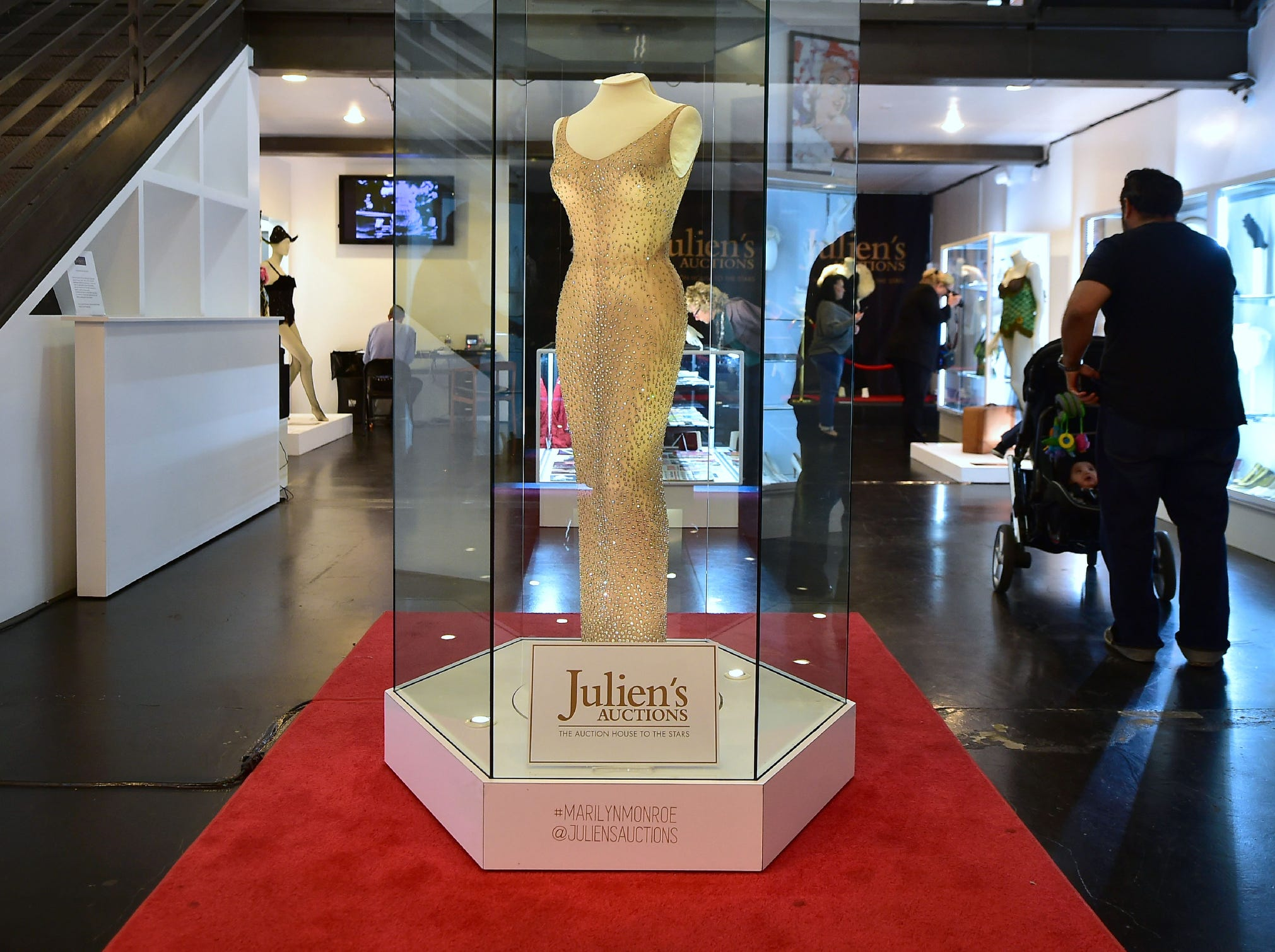 The dress worn by Marilyn Monroe when she sang 'Happy Birthday Mr. President' to  President John F. Kennedy in May 1962, is displayed in a glass enclosure at Julien's Auction House in Los Angeles, on Nov. 17, 2016, ahead of its auction.  Julien's sold the  iconic dress for the record price of $4.81 million USD toRipley's Believe it or Not.