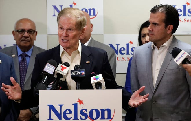 U.S. Sen. Bill Nelson, left, speaks to supporters and members of the media after he was endorsed by Puerto Rico Governor Ricardo Rossello, right, during a news conference Monday Oct. 1, 2018, in Orlando, Fla.