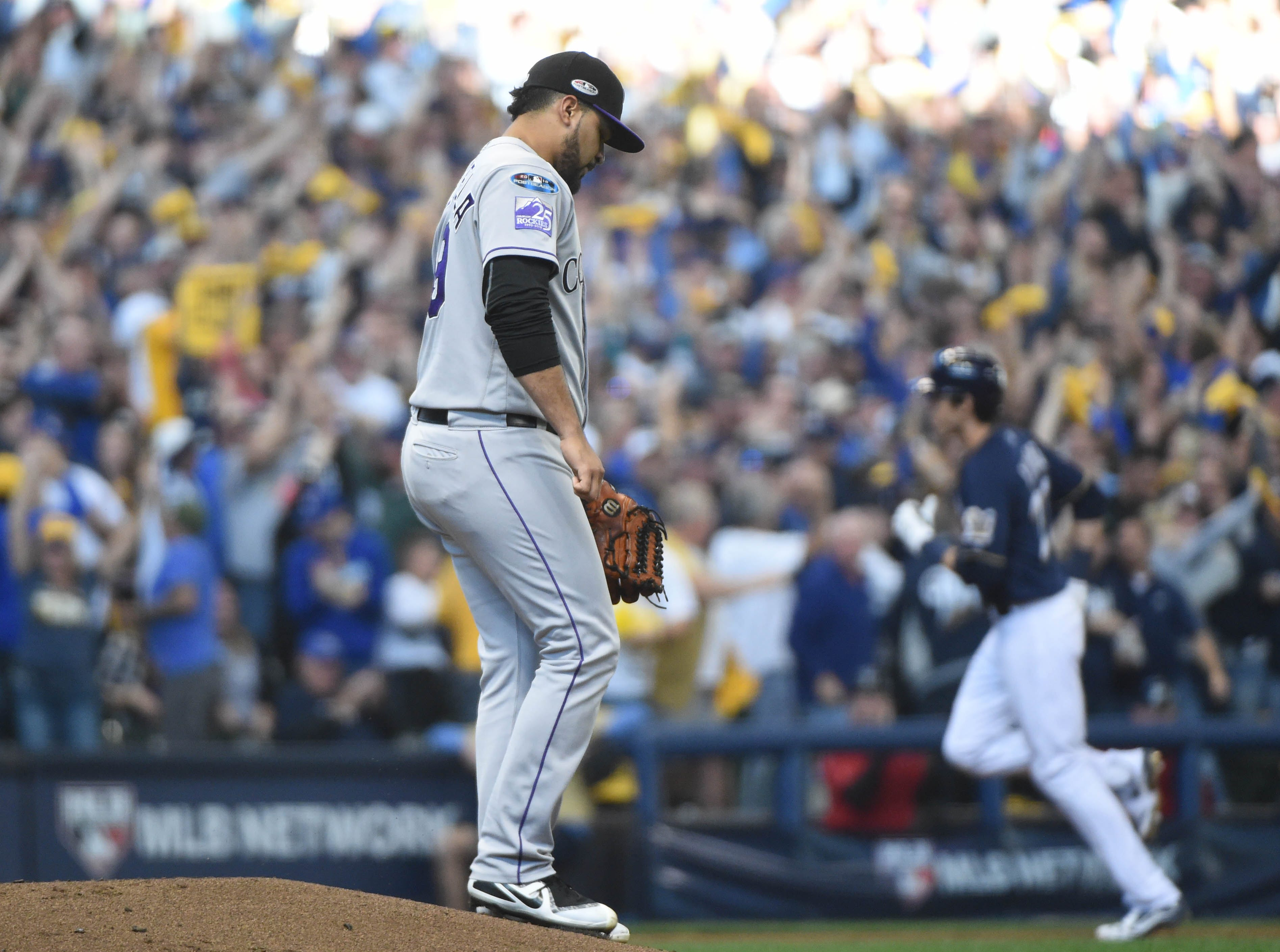 NLDS Game 1: Rockies pitcher Antonio Senzatela reacts after giving up a two-run home run to Christian Yelich in the third inning.