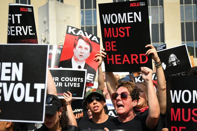 Protesters opposed to Supreme Court nominee Brett Kavanaugh march to the Supreme Court in Washington, Thursday, Oct. 4, 2018.