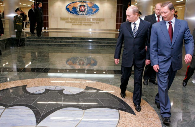 Russian President Vladimir Putin, left, and then Russian Defense Minister Sergey Ivanov, right, visit new headquarters of the Main Directorate of the General Staff of the Armed Forces of the Russian Federation (GRU) in Moscow, Russia, on Nov. 8, 2006. The U.S. Justice Department announced charges Oct. 4, 2018, against seven GRU officers.