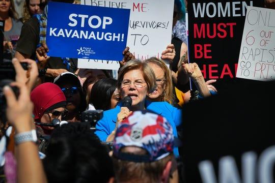 Sen. Elizabeth Warren (D-MA) speaks to protesters against Brett Kavanaugh near the Supreme Court, Thursday, Oct. 4, 2018, in Washington.
