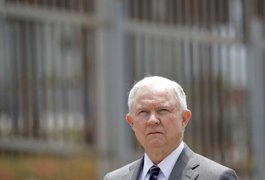 """Attorney General Jeff Sessions listens during a news conference in San Diego near the border with Tijuana, Mexico. Splitting families has emerged as a high-profile and highly controversial practice since Sessions announced a """"zero tolerance"""" policy at the border in early May."""