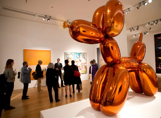Jeff Koons' 'Balloon Dog (Orange)' is displayed Oct. 31, 2013 at Christie's in New York. The mirror-polished stainless steel with transparent color coating sold for $58,405,000 USD on Nov. 12, 2013. That's no play thing!