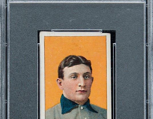 "This Honus Wagner baseball card shattered records for the sale of any baseboard card for $3.2 million USD on Oct. 1, 2016.  The card's description reads:  1909-11 T206 White Border Honus Wagner - PSA EX 5 (MC) - One of the Hobby's Finest: The Magnificent ""Jumbo"" Example, with Outstanding Provenance!  HANDOUT CREDIT: Goldin Auctions"