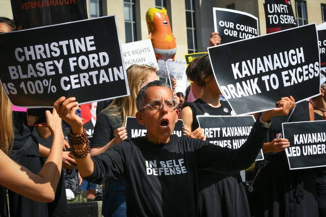 Protesters against Supreme Court nominee Brett Kavanaugh march to the Supreme Court in Washington, Thursday, Oct. 4, 2018.