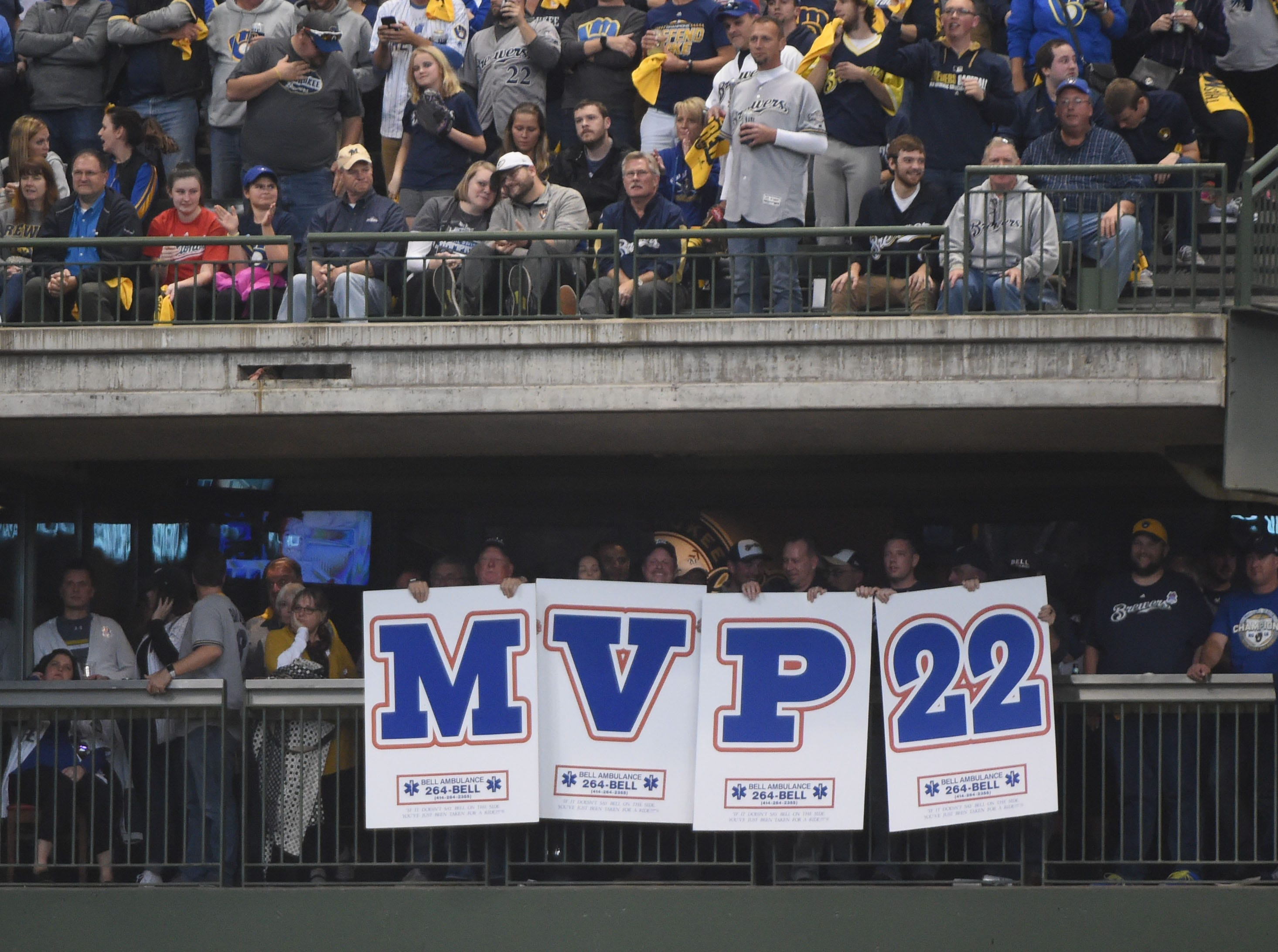 NLDS Game 1: Brewers fans hold up a sign supporting Christian Yelich to win the NL MVP award.