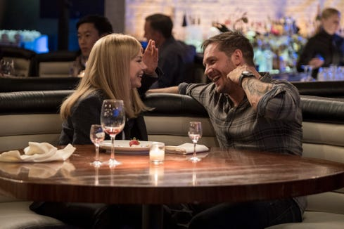 "Anne (Michelle Williams) and Eddie (Tom Hardy) share a laugh in ""Venom."""