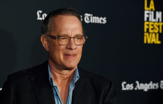 """Tom Hanks took to Twitter call out a fake promotion in Greece using his name. """"Don't be fooled,"""" he said."""