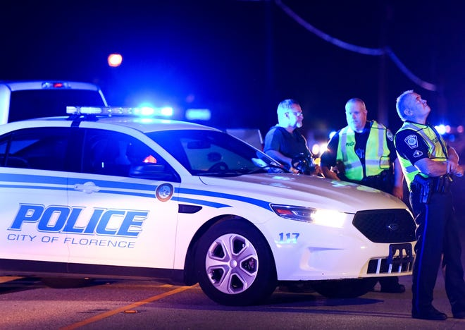 Authorities direct traffic near the Vintage Place neighborhood where several law enforcement officers were shot in Florence, South Carolina.