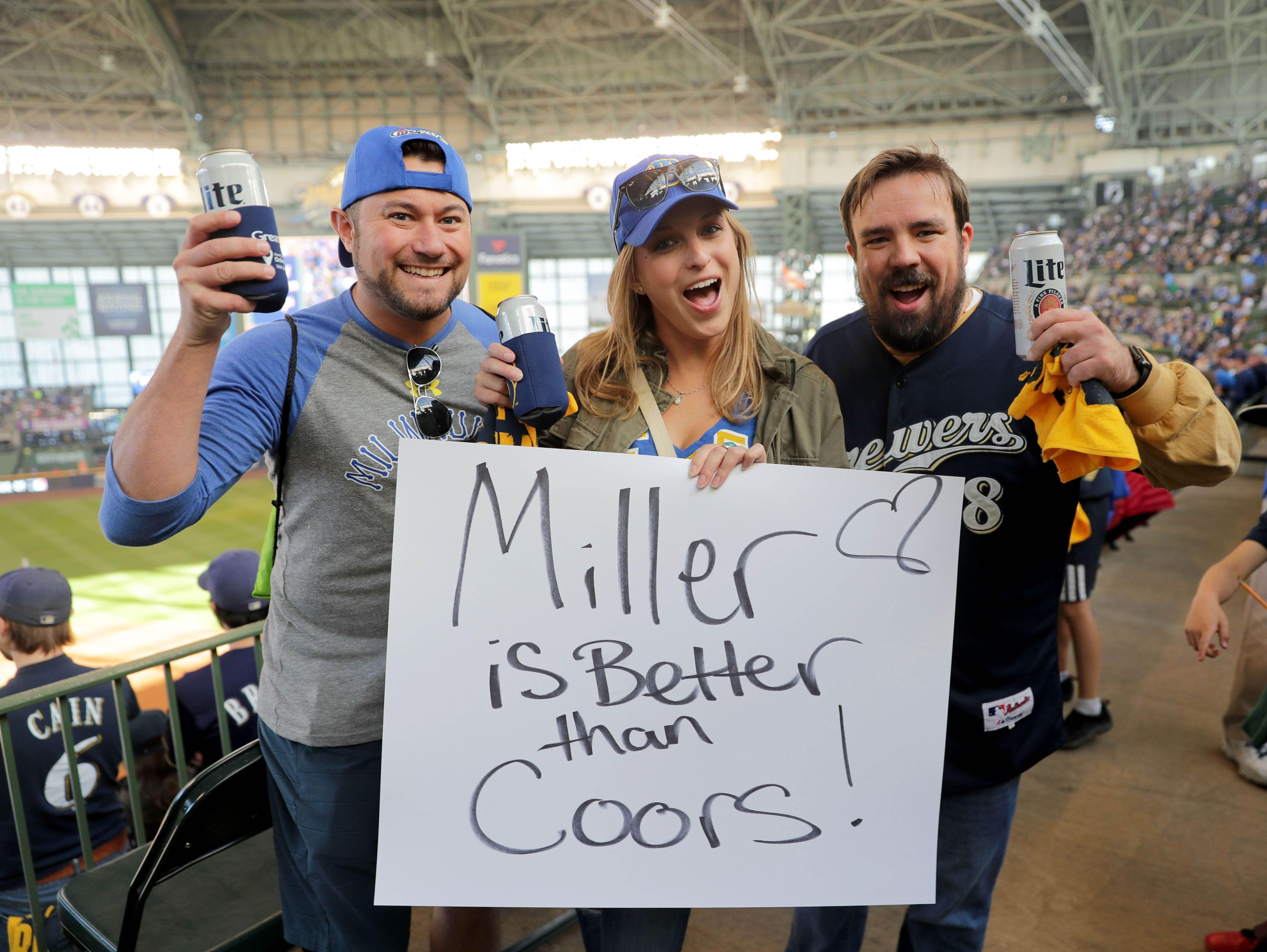 NLDS Game 1: Oct 4, 2018; Brewers fans (from left to right) Kevin Heidorn, Ashley Poull and Kyle Kasbohm hold up a sign.