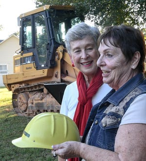 Carole Walters, left, thanks Gloria Bolte for making the first donation toward new homes at the Calvary Home for Children site in Anderson, during a groundbreaking event at the home in Anderson on Thursday.