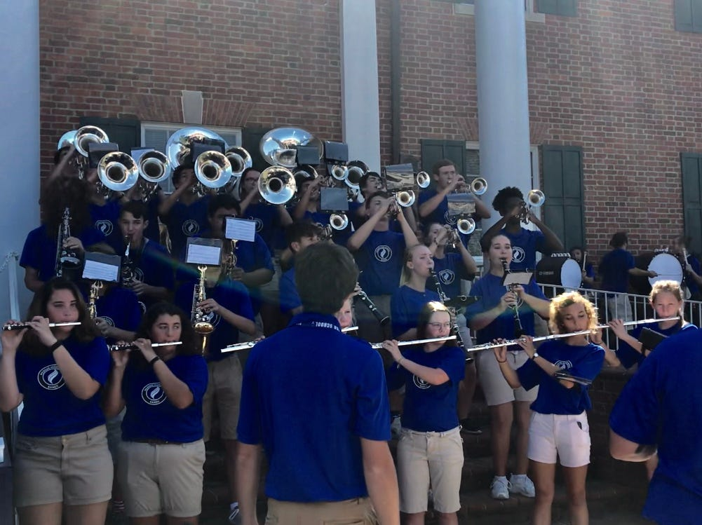 The Pickens High School band warms up the crowd in front of the Pickens County courthouse, awaiting the arrival of Gov. Henry McMaster for the county's Sesquicentennial celebration.