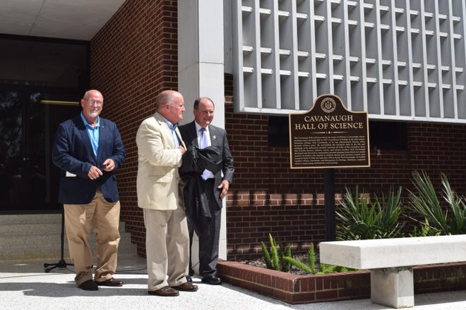 The sons of late Louisiana College professor C.J. Cavanaugh; David Cavanaugh, Lynn Cavanaugh and Robert Cavanaugh unveil a marker in front of Cavanaugh Hall of Science Thursday, Oct. 4, 2018. Professor Cavanaugh had a long tenure at the college located in Pineville.