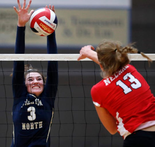 Appleton North's Brianna Cantrell blocks a shot from Kiersten Kraus of Neenah on Thursday. Danny Damiani/USA TODAY NETWORK-Wisconsin