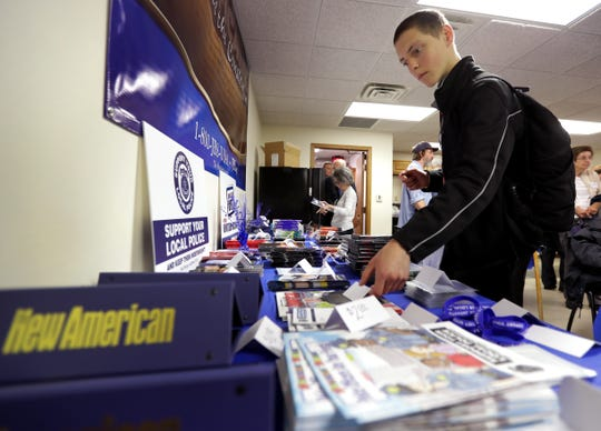 Marcus Farragher of Ohio looks over literature during Friday's open house at the John Birch Society headquarters in Grand Chute. Wm. Glasheen/USA TODAY NETWORK-Wisconsin.