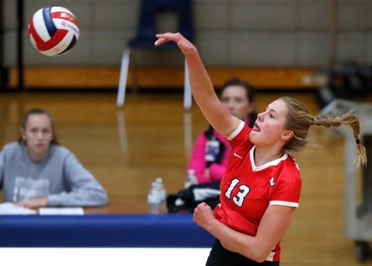 Neenah's Kiersten Kraus sends the ball over the net against Appleton North on Thursday.  Danny Damiani/USA TODAY NETWORK-Wisconsin