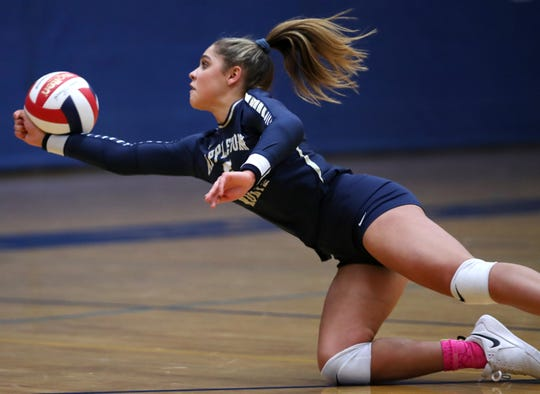 Appleton North's Niki Van Wyk tries to keep the ball in play during Thursday's match against Neenah in Appleton. Danny Damiani/USA TODAY NETWORK-Wisconsin