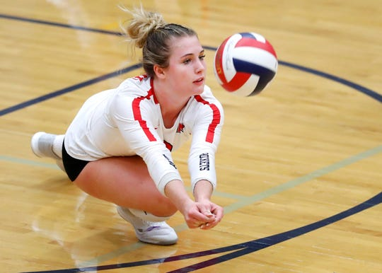 Neenah's Kayla Kraus dives for the ball during their match against Appleton North on Oct. 4 in Appleton.