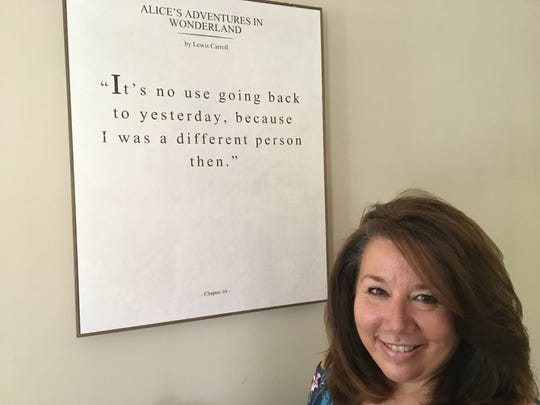 Maureen Spataro with one of her favorite quotations at Marilyn's Place