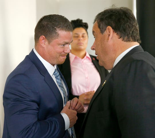 """John Brogan, Toms River, speaks with Chris Christie during a break in the """"Solutions for a New Way Forward"""" panel discussion at Jersey Shore University Medical Center in Neptune, Thursday, May 19, 2016."""
