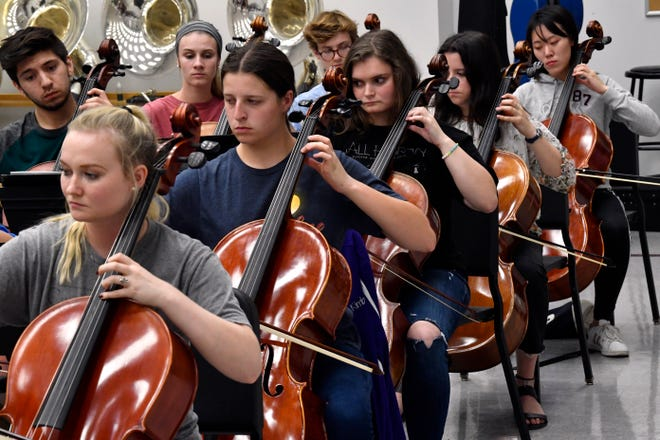 Cellists play music written by Leonard Bernstein during rehearsal for the Civic Orchestra of Abilene at Abilene Christian University Thursday. The group is giving a free concert, featuring music by Bernstein, at 7:30 p.m. Saturday at the Wylie High School Performing Arts Center.