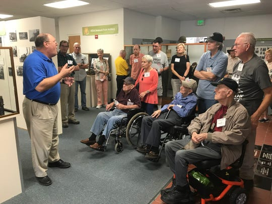 William Lenches, executive director and curator of the 12th Armored Division Memorial Museum, explains to the visiting 416th Bomb Group reunion the challenges he faces explaining life during World War II to younger generations of students. The reunion group, including three World War II veterans in wheelchairs, visited the museum Friday as part of the three-day gathering.