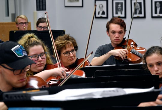 Violinists play during rehearsal for the Civic Orchestra of Abilene Thursday. The Civic Orchestra is made up of musicians from the city's three universities.