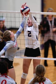 Wylie's Avery Wimberly (2) gets her hands on a block against Cooper at Bulldog Gym on Friday, Oct. 5, 2018.