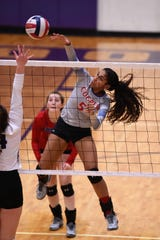 Cooper's Keiana Kemp (5) goes for a kill against Wylie at Bulldog Gym on Friday, Oct. 5, 2018.