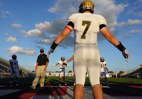 Abilene High defensive lineman J.D. Dugger (7) warms up before Friday's game at Pennington Field in Bedford against 3-6A rival L.D. Bell.