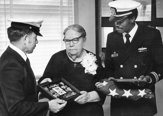 In this file photo from 1977, Ida Mae Goodwin of Haskell, mother of Commander Charles B. Goodwin, accepts the medals her son was awarded posthumously for service in Vietnam. Charles Goodwin was listed as missing in action from 1965 to 1977 when he was declared presumed dead. Presenting the medals are Yeoman First Class Leo Gonzales, left, and Lt. W.L. Allen, commander of the Abilene Naval Reserve Training Center.