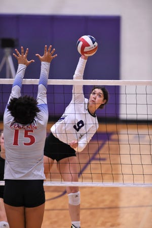 Wylie's Keetyn Davis (9) goes for a kill against Cooper at Bulldog Gym on Friday, Oct. 5, 2018.
