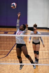 Cooper's Dazz Larkins (12) reaches for the ball against Wylie at Bulldog Gym on Friday, Oct. 5, 2018.